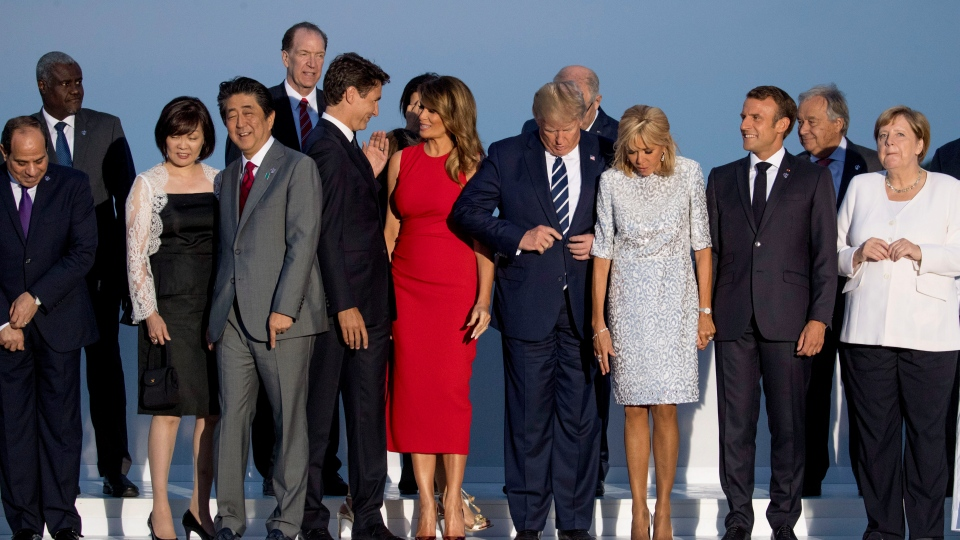 First row from left: Egyptian President Abdel Fattah el-Sissi, Akie Abe, the wife of Japanese Prime Minister Shinzo Abe, Canadian Prime Minister Justin Trudeau, first lady Melania Trump, President Donald Trump, Brigitte Macron, the wife of French President Emmanuel Macron, and German Chancellor Angela Merkel arrive for the G-7 family photo at G-7 summit at the Hotel du Palais in Biarritz, France, Sunday, Aug. 25, 2019. (AP Photo/Andrew Harnik)