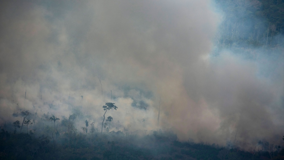 A pall of smoke covers an area of Altamira, Para state, Brazil, Saturday, Aug. 24, 2019. (AP Photo/Leo Correa)
