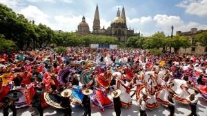 The dancers, who mostly belonged to folk ballet schools, moved to a mix of mariachi standards, dazzling audiences in Guadalajara, Mexico. (AFP)