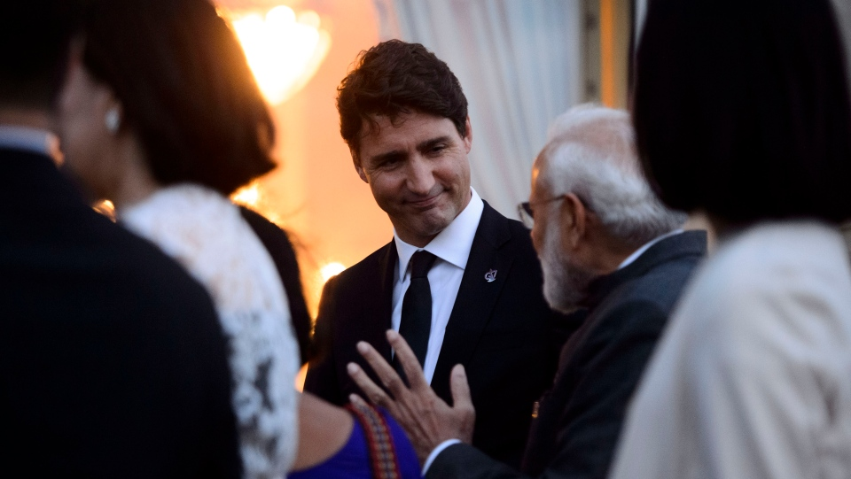 Prime Minister Justin Trudeau talks to Prime Minister of India Narendra Modi following a family photo at the G7 Summit in Biarritz, France on Sunday, Aug 25, 2019. THE CANADIAN PRESS/Sean Kilpatrick