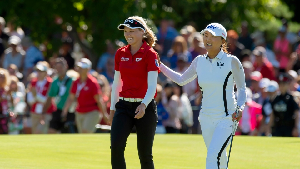 Jin Young Ko of South Korea walks up the eighteenth fairway with Brooke Henderson of Canada on her way to winning the CP Women's Open in Aurora, Ont. on Sunday, August 25, 2019. THE CANADIAN PRESS/Frank Gunn