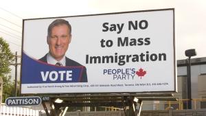 Maxime Bernier mass immigration billboard