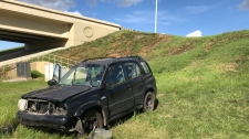 The driver of  black SUV was uninjured Sunday afternoon after he crashed and ended up on an embankment on Gateway Boulevard.