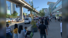 Police and mall security evacuated a busy mall in Surrey Sunday afternoon, leaving shoppers wondering what was going on. (Vincent Benjamin/Twitter)