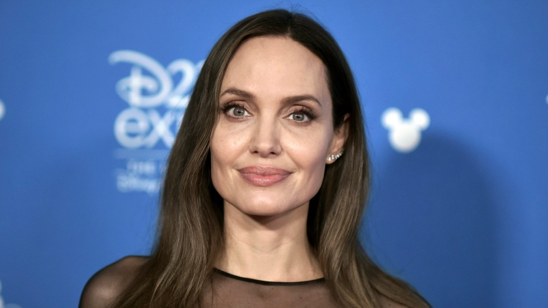 "Angelina Jolie attends the ""Go Behind the Scenes with the Walt Disney Studios,"" press line at the 2019 D23 Expo, Saturday, Aug. 24, 2019, in Anaheim, Calif. (Photo by Richard Shotwell/Invision/AP)"