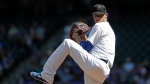 Toronto Blue Jays starting pitcher Clay Buchholz winds up to throw against the Seattle Mariners in the first inning of a baseball game Sunday, Aug. 25, 2019, in Seattle. (AP Photo/Elaine Thompson)