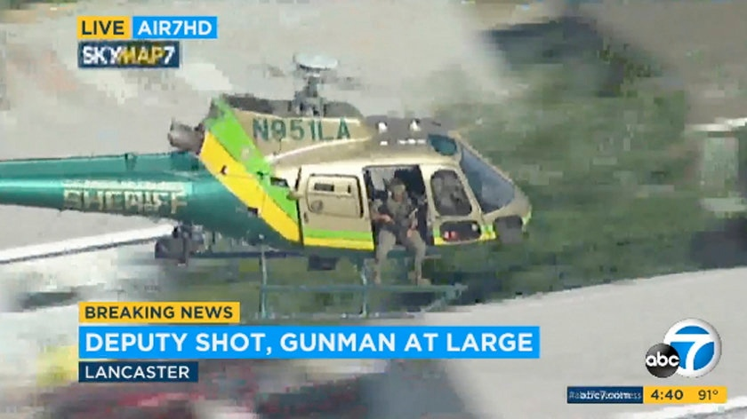 FILE - This Wednesday, Aug. 21, 2019 file image taken from video provided by KABC-TV shows a sheriff's department helicopter with a sniper in an open door searching for a gunman at large in Lancaster, Calif. (KABC-TV via AP, File)