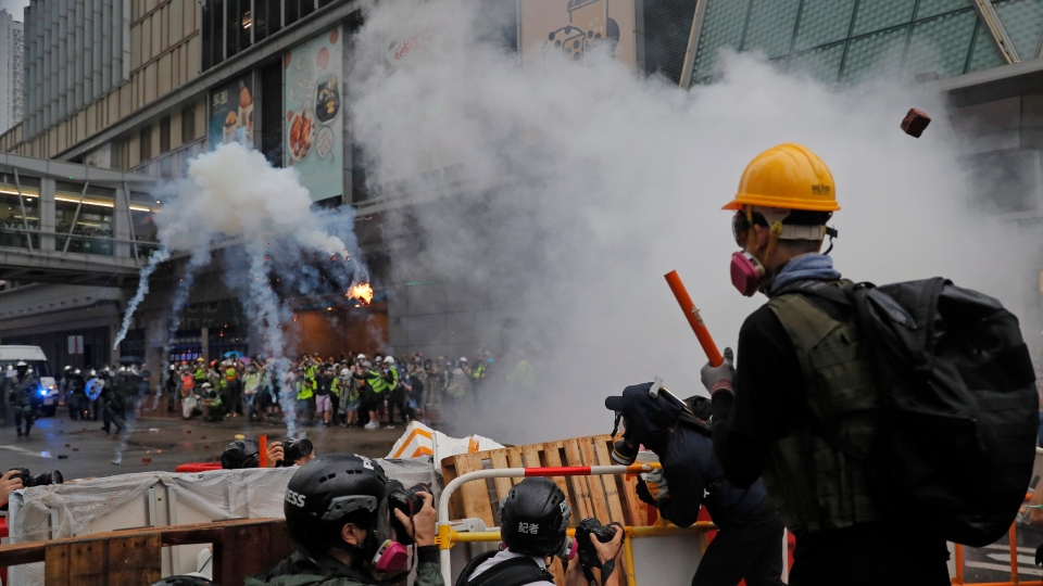 Policemen clash with demonstrators on a street during a protest in Hong Kong, Sunday, Aug. 25, 2019. (AP Photo/Kin Cheung)