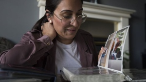 Jessica Sherman looks through pictures of her cousin at her home in Abbotsford, B.C., Wednesday, June 19, 2019. JONATHAN HAYWARD / THE CANADIAN PRESS