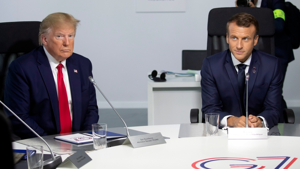 U.S President Donald Trump and French President Emmanuel Macron attend a working session during the G7 summit at Casino in Biarritz, southwestern France, Monday Aug.26 2019. (Ian Langsdon, Pool via AP)