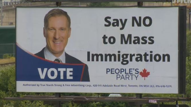 anti-mass immigration billboard