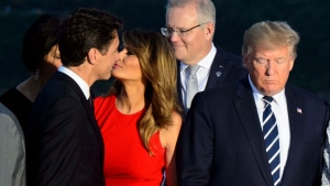 Prime Minister Justin Trudeau greets Melania Trump as she arrives for a family photo with husband U.S. President Donald Trump during the G7 Summit in Biarritz, France on Sunday, Aug. 25, 2019. THE CANADIAN PRESS/Sean Kilpatrick