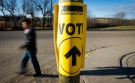 A sign points toward an Elections Canada voting location in this file photo. (THE CANADIAN PRESS / Jeff McIntosh)