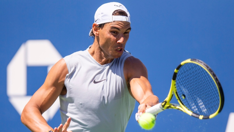 Rafael Nadal, of Spain, returns the ball as he practices for the U.S. Open tennis tournament Saturday, Aug. 24, 2019, in New York. (AP Photo/Eduardo Munoz Alvarez)