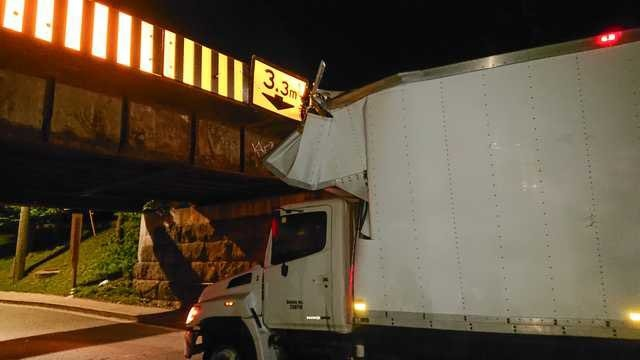 A truck is shown stuck underneath the Talbot Street Bridge in London, Ont. on Sunday, Aug. 25, 2019. (@TalbotSt Bridge / Twitter)