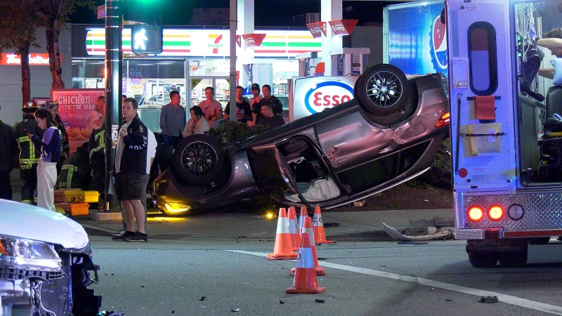 An SUV rolled over and a collided with an Esso sign in Vancouver Monday night.
