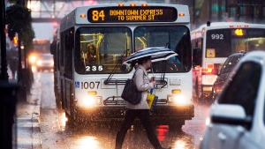 A pedestrian braves heavy rain in Halifax on Friday, Sept. 13, 2013.  (THE CANADIAN PRESS/Andrew Vaughan)