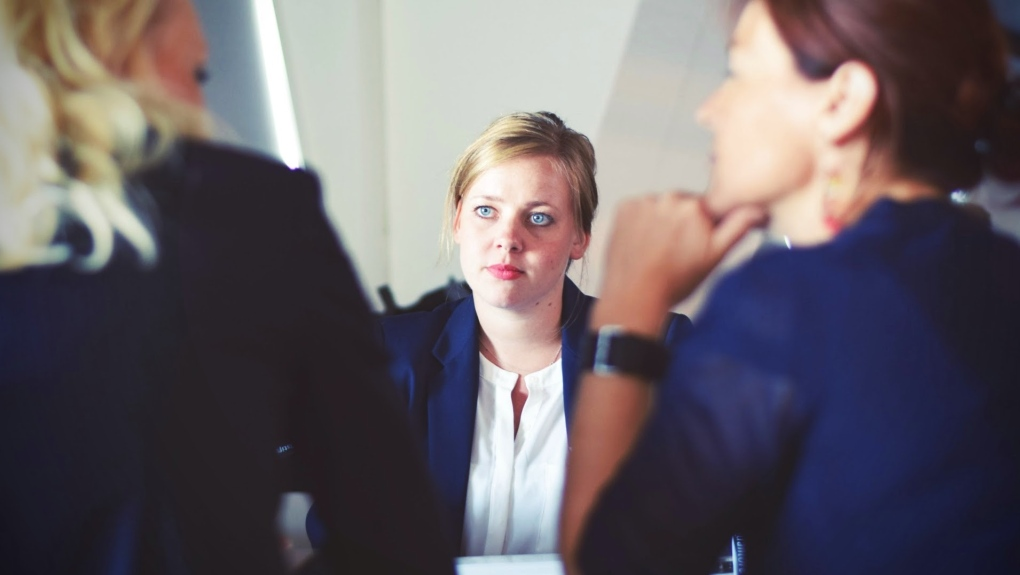 A woman sitting in a meeting