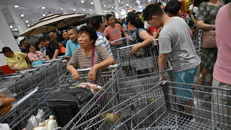 There was shopping cart gridlock for those shoppers lucky enough to get into the story. (AFP)