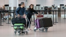 Passengers push their luggage through the departure terminal at Toronto Pearson Airport, in Mississauga, Ont., Friday, May 24, 2019. (THE CANADIAN PRESS / Chris Young)