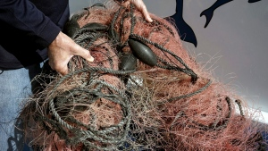 Ottawa says it will spend $8.3-million in an effort to rid Canadian waters of abandoned, lost or discarded fishing gear. Capt. David Anderson, of Captain Dave's Dolphin and Whale Watching Safari, in Dana Point, Calif., shows a net that a whale was found entangled in Monday, Nov. 30, 2015. (THE CANADIAN PRESS/AP-Christine Armario)