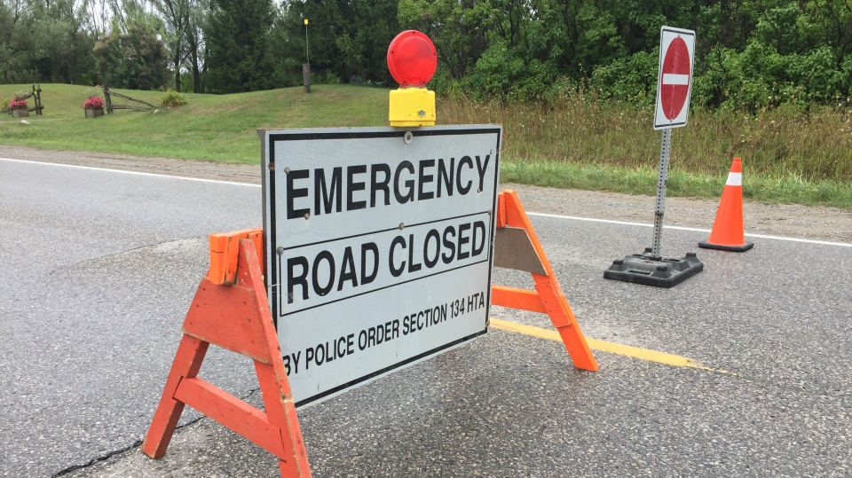 An emergency road closed sign