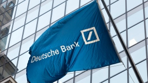 In this Oct. 7, 2016, file photo a flag for Deutsche Bank flies outside the German bank's New York offices on Wall Street. (AP Photo/Mark Lennihan, File)