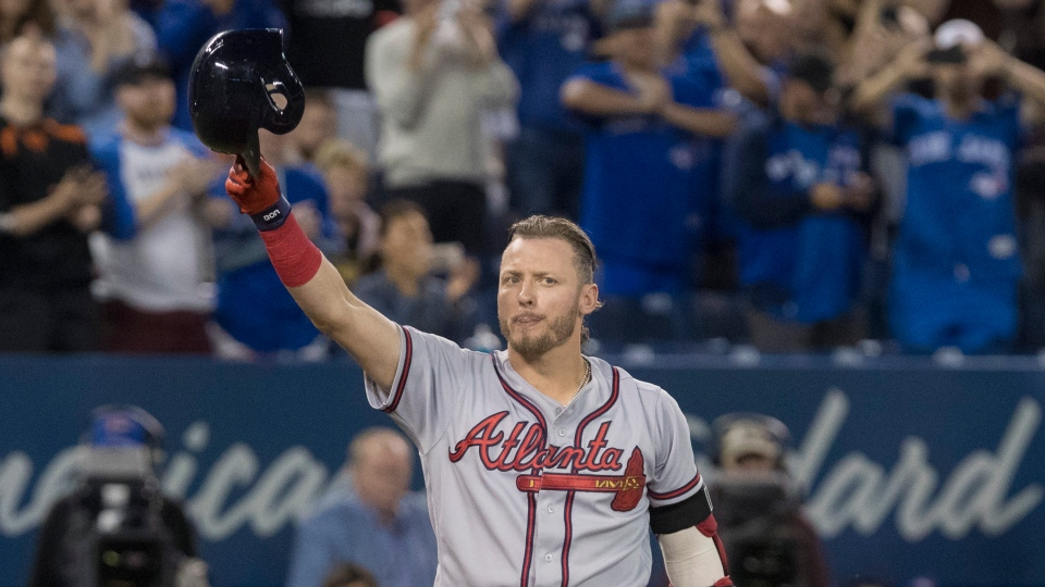 Atlanta Braves' Josh Donaldson acknowledges fans prior to the start of their Interleague MLB baseball game against the Blue Jays in Toronto Tuesday August 27, 2019. THE CANADIAN PRESS/Fred Thornhill