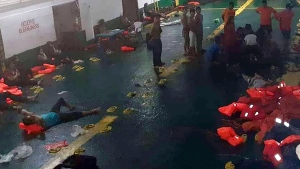 In this photo provided by Philippine Coast Guard in Manila, rescued passengers of the ill-fated M/V Lite Ferry 16, are attended to by the coast guard rescuers and crew of responding vessels, on a ferry which responded to the incident, following an overnight ferry fire Wednesday, Aug. 28, 2019. (Philippine Coast Guard via AP)