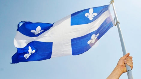 Olivier Racicot holds up a Quebec flag at a rally in Montreal Saturday, June 6, 2009. (Graham Hughes / THE CANADIAN PRESS)