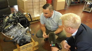 A recycled engine sits on the repair shop floor waiting to be installed.