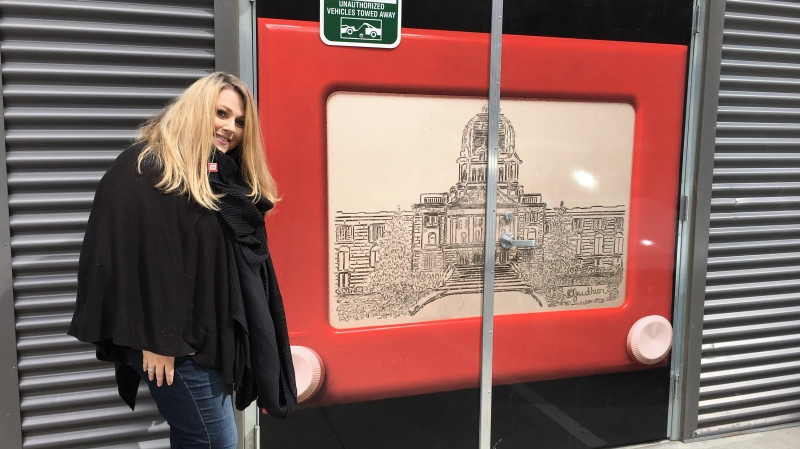 Christine Gauthier with her Etch-a-Sketch art (Taylor Rattray / CTV Regina)