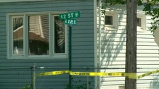 Police tape surrounds the intersection where a stabbing took place Wednesday morning. (CTV Saskatoon)