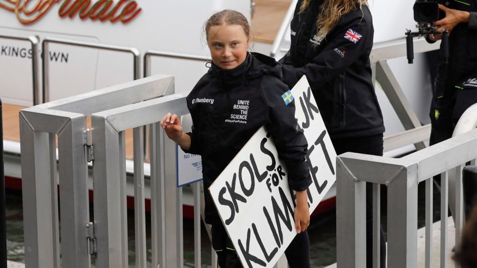 Greta Thunberg, 16, a 16-year-old Swedish environmental activist, arrives in New York, Wednesday, Aug. 28, 2019. (AP Photo/Mark Lennihan)