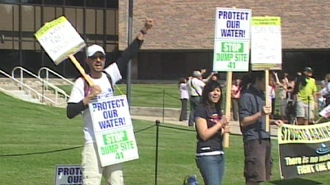 Demonstrators opposed to the Site 41 dump gather outside the County of Simcoe offices in Midhurst on Tuesday, Aug. 25, 2009.