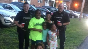 Police officers from the Town of Newburgh Police Department pose for a photo with children at their lemonade stand. (Whitney Glover / Facebook)