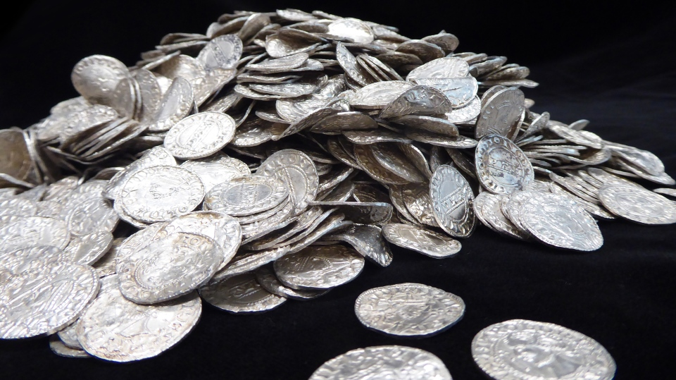 More than 2,500 silver coins dating back to 1066 have been discovered in a U.K. field by a group of people searching the area with metal detectors. (British Museum(