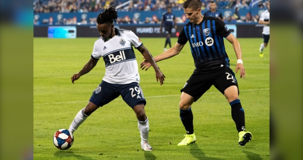 Vancouver Whitecaps forward Yordi Reyna controls the ball away from Montreal Impact defender Jukka Raitala during first half MLS action in Montreal on Wednesday, August 28, 2019. THE CANADIAN PRESS/Paul Chiasson