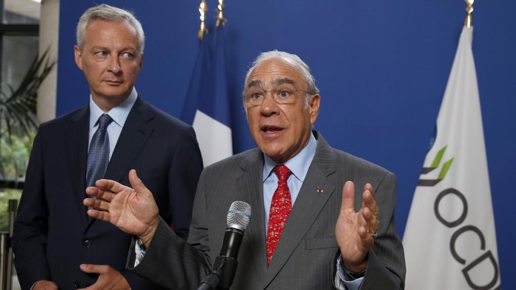 Le Maire, left, and Gurria in Paris
