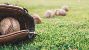 Baseballs and a baseball glove can be seen in this undated image. (Steshka Willems/ Pexels)
