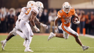 Oklahoma State running back Chuba Hubbard, right, runs down field against the Texas Longhorns in a Oct. 27, 2018 game in Stillwater, Okla. (AP/ Brody Schmidt)