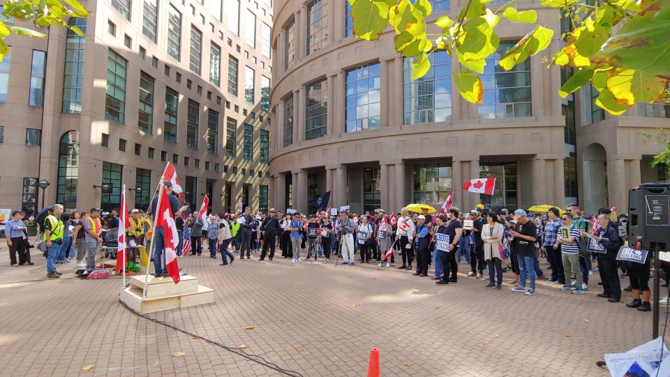 Roughly 250 people gathered at the central branch of the Vancouver Public Library Saturday afternoon to show their support for pro-democracy protesters in Hong Kong. (Ben Miljure/CTV)