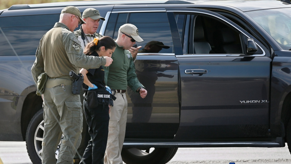 Law enforcement officials process a scene involved in Saturday's shooting, Sunday, Sept. 1, 2019, in Odessa, Texas. B (AP Photo/Sue Ogrocki)
