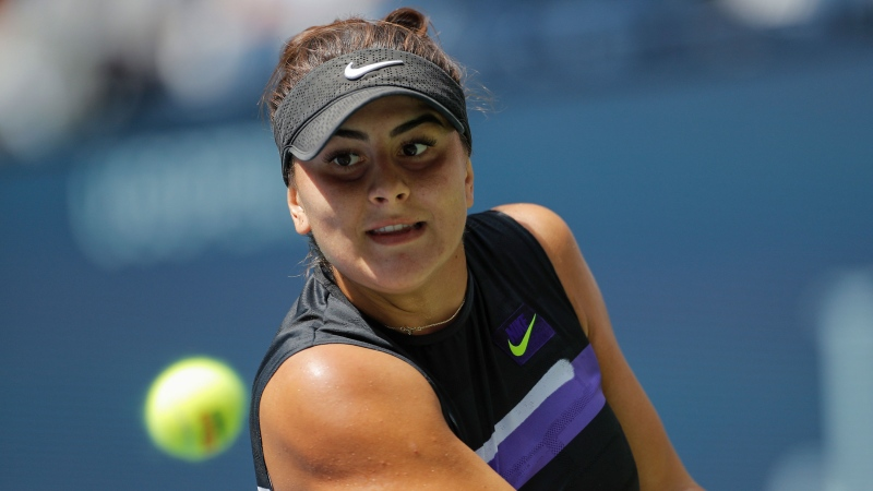 Bianca Andreescu, of Canada, returns a shot to Caroline Wozniacki, of Denmark, during round three of the US Open tennis championships Saturday, Aug. 31, 2019, in New York. (AP Photo/Eduardo Munoz Alvarez)