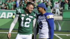 Winnipeg Blue Bombers kicker Justin Medlock (9) congratulates Saskatchewan Roughriders kicker Brett Lauther after Lauther's game winning field goal during second half CFL action in Regina on Sunday, Sept. 1, 2019. THE CANADIAN PRESS/Mark Taylor
