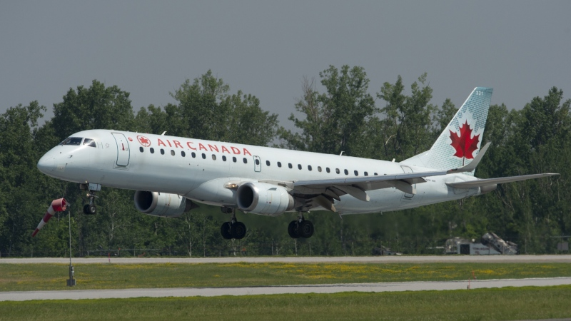 An Air Canada flight makes its final approach as it lands in Ottawa on July 3, 2019. THE CANADIAN PRESS/Adrian Wyld