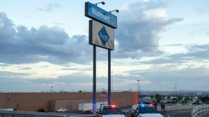 In this Aug. 3, 2019, photo texas state police cars block the access to the Walmart store in the aftermath of a mass shooting in El Paso, Texas. (AP Photo/Andres Leighton, File)