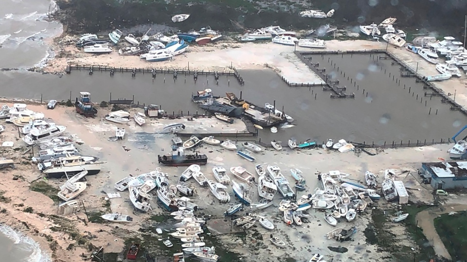 In this Monday, Sept. 2, 2019 photo released by the U.S. Coast Guard Station Clearwater, boats litter the area around marina in the Bahamas after they were tossed around by Hurricane Dorian. (U.S. Coast Guard Station Clearwater via AP)