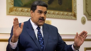 In this Feb. 14, 2019 file photo, Venezuela's President Nicolas Maduro speaks during an interview with The Associated Press at Miraflores presidential palace in Caracas, Venezuela. (AP Photo/Ariana Cubillos, File)