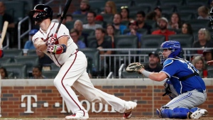 Atlanta Braves' Tyler Flowers follows through on a three-run double in front of Toronto Blue Jays catcher Beau Taylor during the eighth inning of a baseball game Tuesday, Sept. 3, 2019, in Atlanta. (AP Photo/John Bazemore)